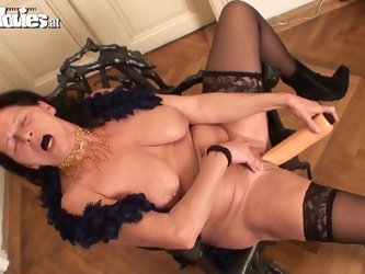 Chubby mature fucks herself with a huge dildo