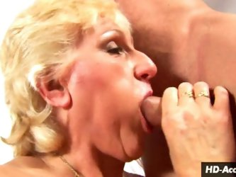 Blonde granny gives a great titty fuck