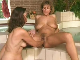 Two hairy lesbian milfs fisting
