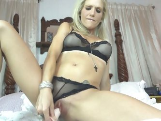 Milfs toys her ass and blows cock