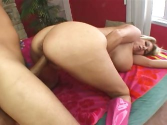 Busty blonde takes the stiff cock from behind
