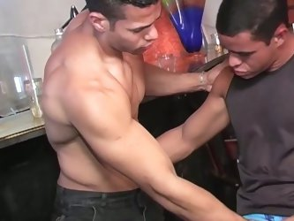 Muscular barman drilling customer to satisfaction