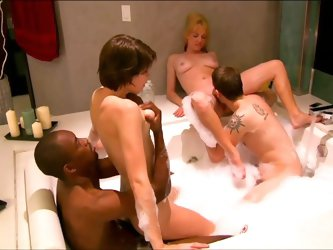 Swinging interracial foursome in the shower