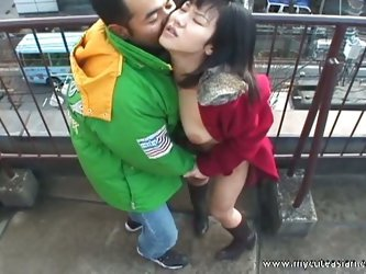 Asian hottie strips and blows outside