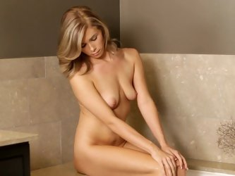 Kendall gets naked and masturbates shaved puss
