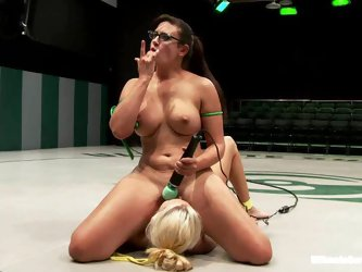 Busty blondie is being dominated by a horny brunette