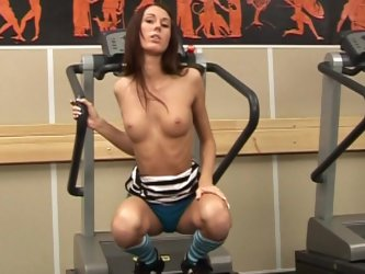 Beauty with long legs is playing with a dildo