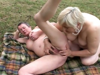 Two grannies having lesbian sex in outdoor