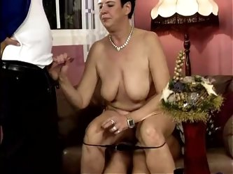 That mature and hairy pussy gets two hard cocks