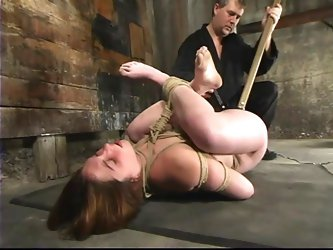 Hog tied Ginger gets her vagina stuffed with a stick