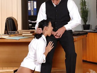 Horny schoolgril giving head to her principal