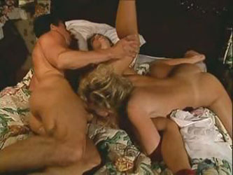 Kylie Ireland, Nici Sterling and Peter North have a nasty three-way in this vintage clip