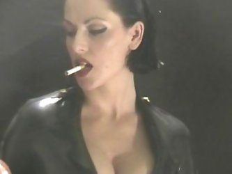 Adorable smoking mistress in latex rubber