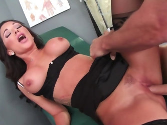 This busty brunette babe is a doctor who's getting ready to take over the medical practice from her older colleague, but he objects. So she wants