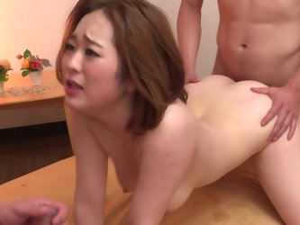 Redhead Asian babe Doremi Miyamoto is being fucked by these two studs. One gets the blowjob and the other one gets that pussy, and this babe is defini