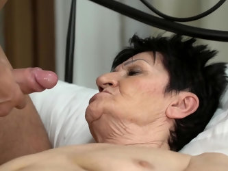 Brunette mature woman is irresistibly fascinating so porn actor can't resist nailing her pussy. Young man slowly takes white underwear down and s