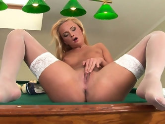 The game of pool this blondie wants to play is beyond naughty