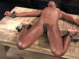The beautiful ebony babe Ana Foxx is blindfolded and dominated on a hard wood floor before being subjected to soft spanking and tickling by her master