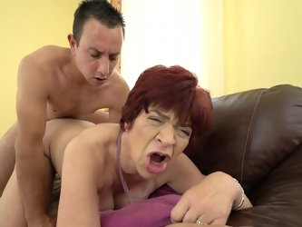 Granny opens up her meat curtains and she gets them fucked by this young dude with a hard on. His stiff cock is making some nasty moves inside her and