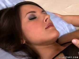 Touchy lack haired babe Demi in sexy neglige and black thongs lies on the bed and takes off her bra. Her boobies looks fantastic when she slowly rubs