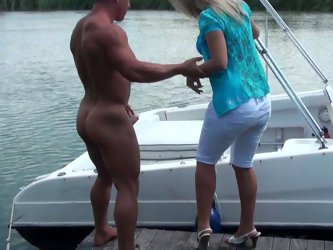 Naked dude invites his chubby blonde milf girlfriend for a boat ride. It ended up by eating her bald wet pussy and fucking missionary style.