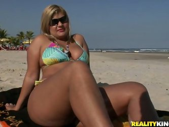 During jugging at the beach, sex hungry black daddy notices a tasty blond mature in seductive tiny bikini. He gets to her to look at her closer in ord