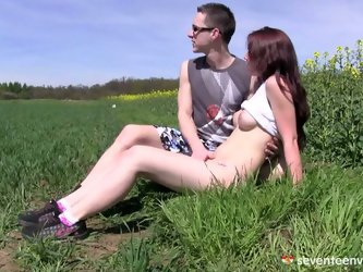 Charlotte gets out in the field with her boyfriend. There, they feel safe enough to have sex. She loves it when he goes down on her and eats her pussy