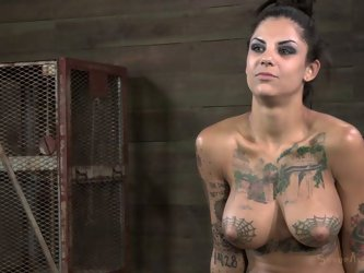 She is raunchy BDSM performer who has no limits. Here in this video she gives an interview naked demonstrating her gorgeous tatted body.
