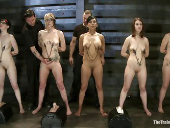 These slave women are lined up in a row and ready for some weight torture. The master attaches chains to all the girl's nipples. Next come the st
