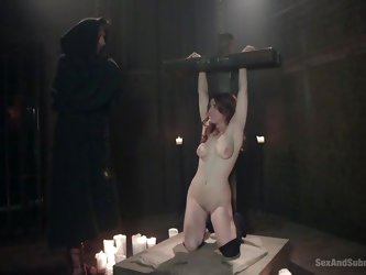 Back in the 1800s it seems everyone was a creep. This couple watches a weird ritual with a woman in prison. She slave gets clamps put on her nipples a