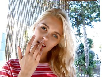 Sasha, a sweet blonde girl with thin body, small tits and long sexy legs is sucking her fingers with lust and rubs her clitoris. She is a horny cutie