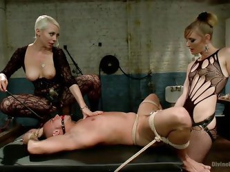 This male slave is in for some serious pain now that these two amazing looking dominatrix women have him tied up in rope. They stretch his asshole wit