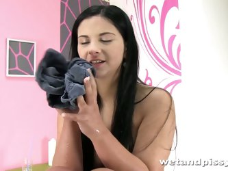 Full natural brunette pisses in jeans shorts and masturbates punani