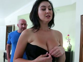 She is wearing sexy black dress barely covering her huge tits. She reveals her boobs and squeezes the dude's face between her twins. Later she gi