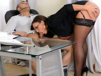 This amazing nerdy boss has her own method to get rid of stress. Spoiled lady in glasses in classic office suit undresses slowly to pose in her black