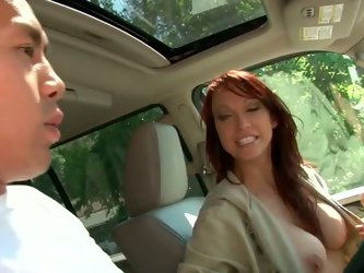 She rides around the block and picks up a guy offering him a ride. She seduces him in the car flashing her tits and letting him touch firm nipple. So