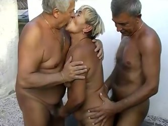 Dirty and kinky granny is lying naked on a couch. She is getting her slick cunt rubbed and fingered actively. She also gives head to horny old uncle.