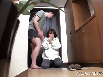 This fully clothed mature Japanese lady grabs her man's cock in the middle of the night. She tugs him off and before long she is on her knees suc