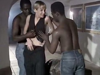 Perverted vintage blond housewife has crazy sex fun with two BBCs. She sucks their hard cocks standing on knees while her husband is out of town.