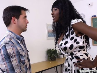Hot ebony teacher Nyoni Banxx is wearing polka dot dress. She is angry with her student who misbehaves in class. But anyway she wants to suck the hand