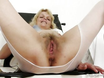 This chubby blonde women is sitting on gynecologist table wearing only a pair of white pantyhose. She have big tits and hairy large pussy. The slut is
