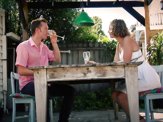After a glass of wine on the porch, this couple thinks to serve the dessert. The guy undresses his partner who is wearing a white dress and a pink bra