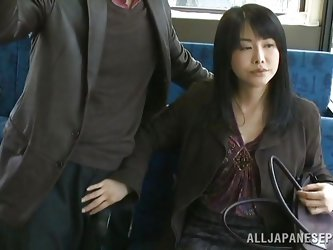 This sexy clerk is coming home from the office on the bus. A man is standing beside her and she accidentally, brushes her hand up against his crotch.