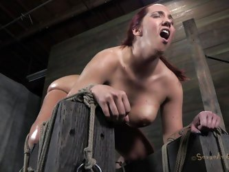 Oiled and tied up our redhead receives a deep mouth fucking from her executor. He is not joking around and gives this whore one hell of a fuck. She si