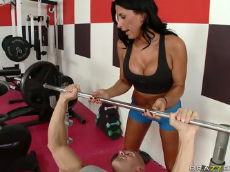 Lazley Zen works at local gym. Busty brunette teaches him to work out. Then she gives him blowjob, gets naked and rides on his cock.