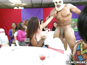 They are all in a wild party mood as the guy strips of everything but his mask and ladies asks him to join her in sucking her boobs and then he licks