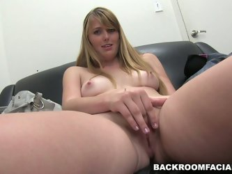 She sits all naked on a leather couch in the producer's office and shows how she warms herself before the sex. She rubs her pussy and fingers her