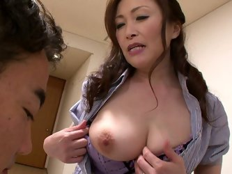 She is experienced porn star having big natural boobs and tasty pink snatch. She flashes her tits to the guy letting him suckle her nipples. Then she