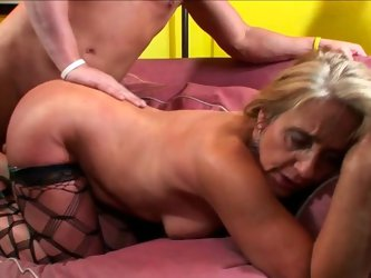 This granny looks very tempting in her sexy fishnet stockings! Sex-starved slut gets down on all fours to let her lover pound her fanny hard. Horny st