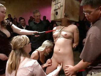 With her head in a box and the rest of her body tied up, we can definitely say that this whore is a special package here at Public Disgrace. The guys